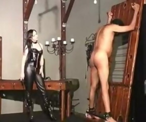 Dominatrix in black leather..
